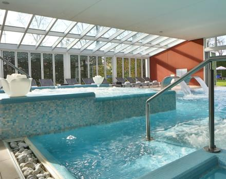 Heated dynamic swimming-pool with fountains and whirlpools.